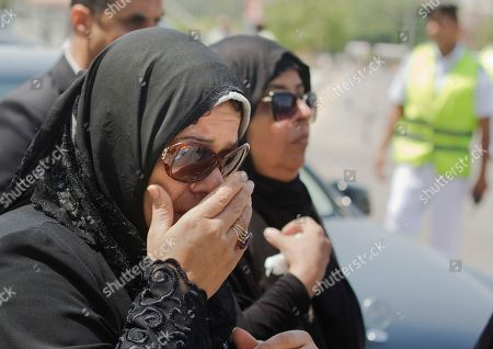 Sisters of Egyptian-American Nobel Laureate Ahmed Zewail grieve as they arrive to Cairo International Airport to receive the body of their brother, in Cairo, Egypt