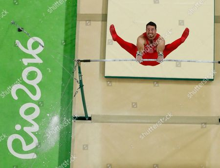 Britain's Kristian Thomas performs on the horizontal bar during the artistic gymnastics men's qualification at the 2016 Summer Olympics in Rio de Janeiro, Brazil