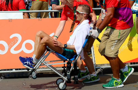 Men's 50km Race Walk Final. Australia's Jared Tallent, who finished in second, is helped off the course after the race