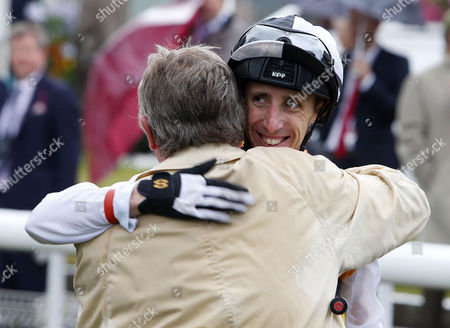 Stock Photo of George Baker gets a hug from Charlie Gordon Watson after winning The Weatherbys Hamilton Lonsdale Cup York