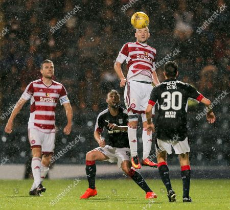 Grant Gillespie of Hamilton Academical jumps to head the ball as heavy rain falls during the SPFL Ladbrokes Premiership match between Dundee and Hamilton Academical at Dens Park, Dundee on 19th August
