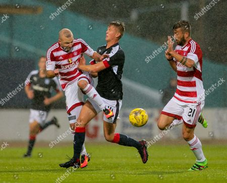 Grant Gillespie of Hamilton Academical collides with Mark O?Hara of Dundee, with Massimo Donati of Hamilton Academical, right, during the SPFL Ladbrokes Premiership match between Dundee and Hamilton Academical at Dens Park, Dundee on 19th August