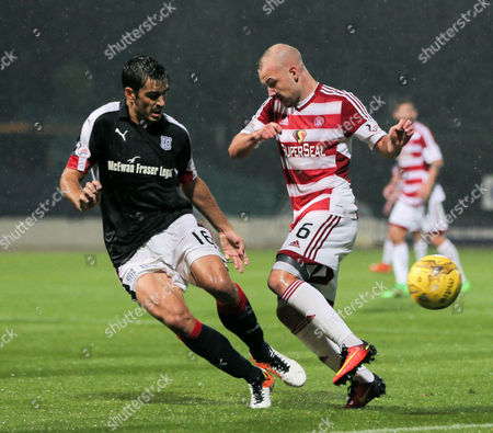 Julen Etxabeguren of Dundee blocks Grant Gillespie of Hamilton Academical during the SPFL Ladbrokes Premiership match between Dundee and Hamilton Academical at Dens Park, Dundee on 19th August