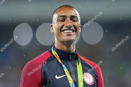 Stock Image of United States' gold medal winner Ashton Eaton celebrate during the medal ceremony for the decathlon, in the athletics competitions of the 2016 Summer Olympics at the Olympic stadium in Rio de Janeiro, Brazil, Friday, Aug. 19, 2016