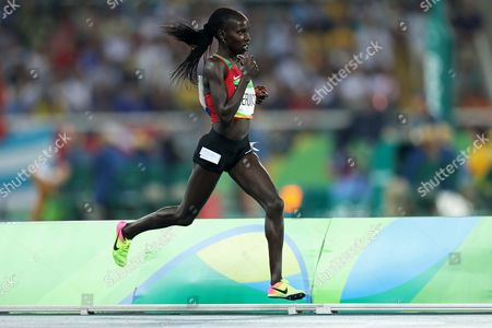 Kenya's gold medal winner Vivian Jepkemoi Cheruiyot during the athletics competitions of the 2016 Summer Olympics at the Olympic stadium in Rio de Janeiro, Brazil, Friday, Aug. 19, 2016