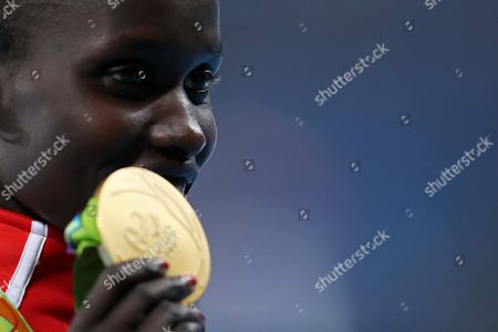 Kenya's gold medal winner Vivian Jepkemoi Cheruiyot celebrates ceremony victory during the athletics competitions of the 2016 Summer Olympics at the Olympic stadium in Rio de Janeiro, Brazil, Friday, Aug. 19, 2016