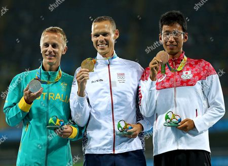 Jared Tallent of Australia, Matej Toth of Slovakia and Hirooki Arai of Japan during ceremony victory of Men's 50km Race Walk the athletics competitions at 2016 Summer Olympics at the Olympic stadium in Rio de Janeiro, Brazil, Friday, Aug. 17, 2016