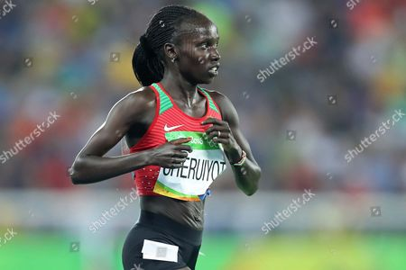 Stock Picture of Kenya's gold medal winner Vivian Jepkemoi Cheruiyot during ceremony victory Women's 5000m the athletics competitions of the 2016 Summer Olympics at the Olympic stadium in Rio de Janeiro, Brazil, Friday, Aug. 19, 2016