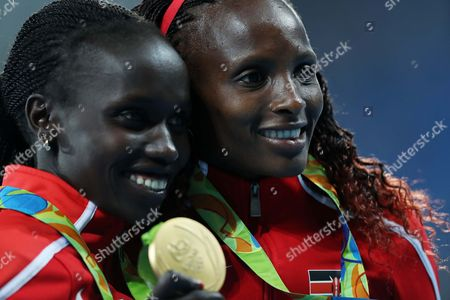 Stock Photo of Kenya's gold medal winner Vivian Jepkemoi Cheruiyot and Kenya's silver medal winner Hellen Onsando Obiri during victory ceremony Women's 5000m the athletics competitions of the 2016 Summer Olympics at the Olympic stadium in Rio de Janeiro, Brazil, Friday, Aug. 19, 2016