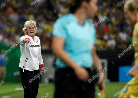 Germany coach Silvia Neid instructs her players from the sideline during the final match of the women's Olympic football tournament between Germany and Sweden at the Maracana stadium in Rio de Janeiro, Brazil, . Germany won gold medal after beating Sweden 2-1