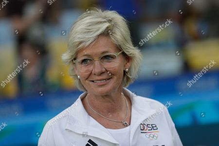 Germany coach Silvia Neid smiles before the final of the women's Olympic football tournament between Germany and Sweden at Maracana stadium in Rio de Janeiro, Brazil