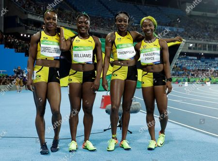 Jamaica's Christania Williams, Elaine Thompson, Veronica Campbell-Brown and Shelly-Ann Fraser-Pryce celebrate winning the silver medal in the women's 4 x 100-meter relay final, during the athletics competitions of the 2016 Summer Olympics at the Olympic stadium in Rio de Janeiro, Brazil
