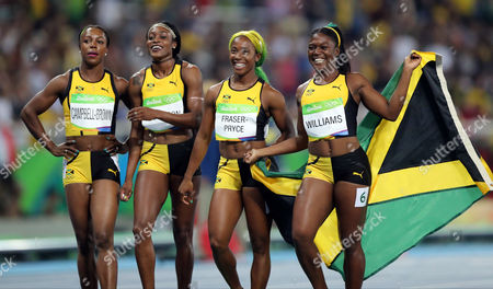 The Jamaica team from left, Veronica Campbell-Brown, Elaine Thompson, Shelly-Ann Fraser-Pryce and Christania Williams celebrate winning the silver medal in the women's 4 x 100-meter relay final, during the athletics competitions of the 2016 Summer Olympics at the Olympic stadium in Rio de Janeiro, Brazil