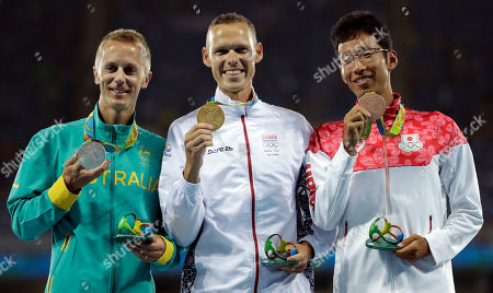 Gold medal winner Slovakia's Majej Toth, center, silver medal winner Australia's Jared Tallent and bronze medal winner Japan's Hirooki Arai after the award ceremony for the men's 50km walk during the athletics competitions of the 2016 Summer Olympics at the Olympic stadium in Rio de Janeiro, Brazil