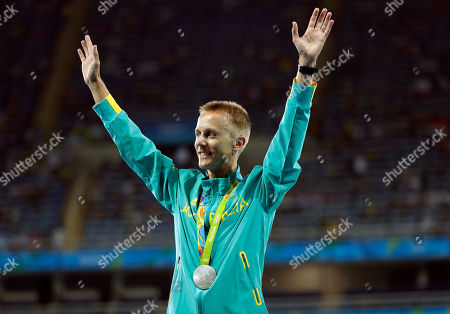 Silver medal winner Australia's Jared Tallent celebrates after the award ceremony for the men's 50km walk during the athletics competitions of the 2016 Summer Olympics at the Olympic stadium in Rio de Janeiro, Brazil