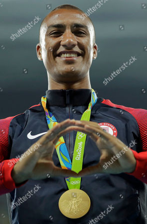 Gold medal winner, United States' Ashton Eaton gestures during the medal ceremony for the decathlon, in the athletics competitions of the 2016 Summer Olympics at the Olympic stadium in Rio de Janeiro, Brazil