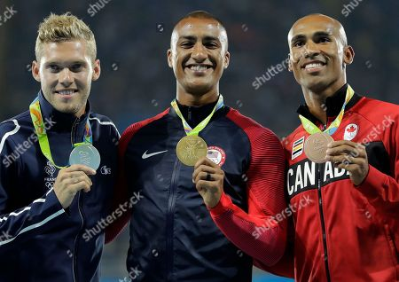 United States' gold medal winner Ashton Eaton is flanked by France's silver medal winner Kevin Mayer and Canada's bronze medal winner Damian Warner celebrate during the medal ceremony for the decathlon, in the athletics competitions of the 2016 Summer Olympics at the Olympic stadium in Rio de Janeiro, Brazil