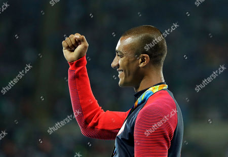 United States' Ashton Eaton celebrates during the medal ceremony for the decathlon, in the athletics competitions of the 2016 Summer Olympics at the Olympic stadium in Rio de Janeiro, Brazil