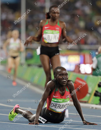 Kenya's Vivian Jepkemoi Cheruiyot celebrates winning the gold medal and setting a new Olympic record in the women's 5000-meter final during the athletics competitions of the 2016 Summer Olympics at the Olympic stadium in Rio de Janeiro, Brazil
