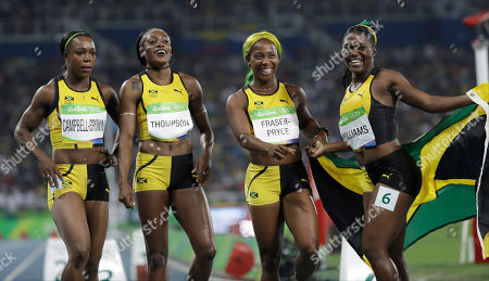 Stock Image of The Jamaica team, from left, Veronica Campbell-Brown, Elaine Thompson, Shelly-Ann Fraser-Pryce and Christania Williams celebrate winning the silver medal in the women's 4x100-meter relay final during the athletics competitions of the 2016 Summer Olympics at the Olympic stadium in Rio de Janeiro, Brazil