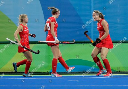 Britain's Crista Cullen, right, celebrates with teammates her goal against Netherlands, during a women's field hockey gold medal match at 2016 Summer Olympics in Rio de Janeiro, Brazil