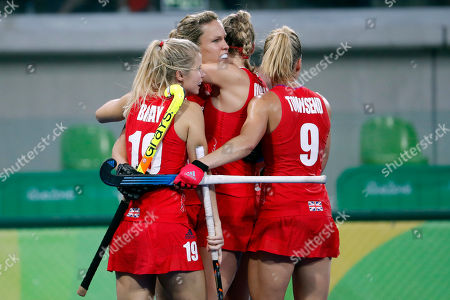 Britain's Crista Cullen, center, celebrates after scoring against Netherlands during a women's field hockey gold medal match at the 2016 Summer Olympics in Rio de Janeiro, Brazil