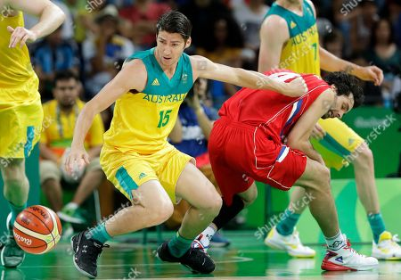 Stock Image of Australia's Damian Martin (15) fights for a loose ball with Serbia's Milos Teodosic, right, during a semifinal round basketball game at the 2016 Summer Olympics in Rio de Janeiro, Brazil