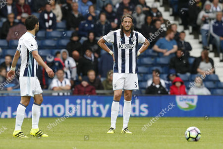 Jonas Olsson shows a look of dejection after Everton score their first goal during the Premier League match between West Bromwich Albion and Everton played at The Hawthorns, West Bromwich on 20th August 2016