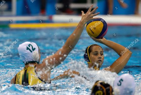 Spain's Matilde Ortiz Reyes,right, passes the ball forward as Australia's Nicola Zagame during their women's classification 5th-6th place water polo match at the 2016 Summer Olympics in Rio de Janeiro, Brazil