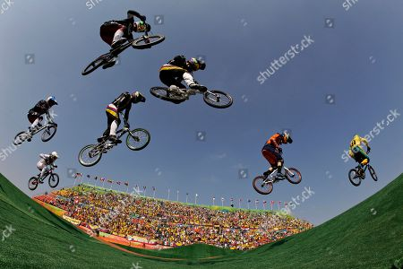 Cyclists, from left, Anthony Dean of Australia, Jelle van Gorkom of the Netherlands, Carlos Ramirez Yepes of Colombia, Carlos Oquendo Zabala of Colombia, Nicholas Long of the United States, Corben Sharrah of the United States and Luis Brethauer of Germany compete in the men's BMX cycling semifinal during the 2016 Summer Olympics in Rio de Janeiro, Brazil