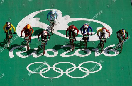 Cyclists, from right, Mariana Pajon of Colombia, Stefany Hernandez of Venezuela, Manon Valentino of France, Simone Christensen of Denmark, Maria Gabriela Diaz of Argentina, Alise Post of the United States, merle van Benthem of the Netherlands, Amanda Carr of Thailand compete in the women's BMX cycling semifinals during the 2016 Summer Olympics in Rio de Janeiro, Brazil