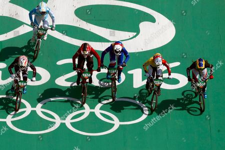Cyclists, from right, Mariana Pajon of Colombia, Stefany Hernandez of Venezuela, Manon Valentino of France, Simone Christensen of Denmark, Maria Gabriela Diaz of Argentina and Alise Post of the United States compete in the women's BMX cycling semifinals during the 2016 Summer Olympics in Rio de Janeiro, Brazil