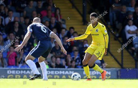 Daniel Leadbitter of Bristol Rovers runs at Adam Barrett of Southend United with the ball