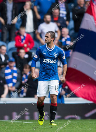 Niko Kranjcar of Rangers puffs himself up as he walks back to the halfway line following Kenny Miller's late winner for Rangers during the SPFL Ladbrokes Premiership match between Rangers and Motherwell at Ibrox Stadium, Glasgow on 20th August