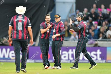 Alex Wakely and Josh Cobb celebrate the wicket of Ryan Pringle (not shown) during the NatWest T20 Finals Day 2016 match between Northamptonshire County Cricket Club and Durham County Cricket Club at Edgbaston, Birmingham