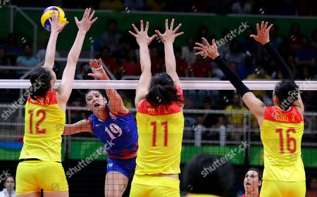 Serbia's Tijana Boskovic (19) spikes the ball as China's Hui Ruoqi (12), Xu Yunli (11) and Ding Xia (16) defend during a women's gold medal volleyball match at the 2016 Summer Olympics in Rio de Janeiro, Brazil