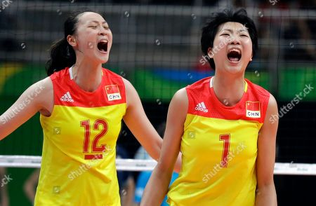China's Yuan Xinyue, right, celebrates with teammate Hui Ruoqi during a women's gold medal volleyball match against Serbia at the 2016 Summer Olympics in Rio de Janeiro, Brazil