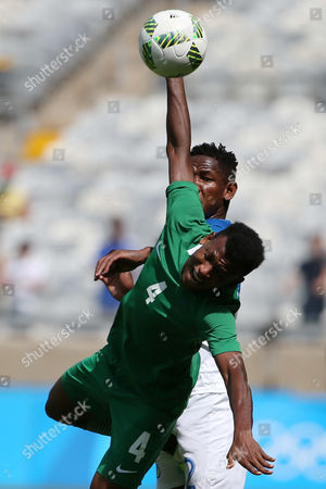 Nigeria's Abdullahi Shehu, front, and Honduras' Romell Quioto vie for the ball during the bronze medal match of the men's Olympic football tournament between Honduras and Nigeria at Mineirao stadium in Belo Horizonte, Brazil