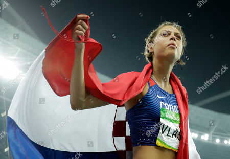 Croatia's Blanka Vlasic celebrates winning the bronze medal after the women's high jump during the athletics competitions of the 2016 Summer Olympics at the Olympic stadium in Rio de Janeiro, Brazil