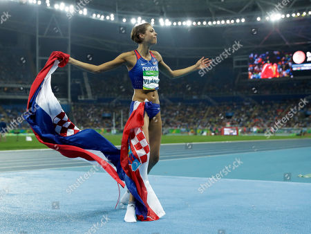 Croatia's Blanka Vlasic celebrates winning the bronze medal in the women's high jump final, during the athletics competitions of the 2016 Summer Olympics at the Olympic stadium in Rio de Janeiro, Brazil