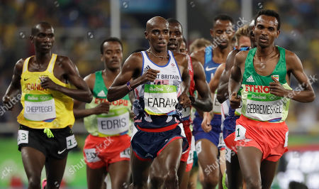 Stock Photo of Britain's Mo Farah, center, and Ethiopia's Dejen Gebremeskel, right, compete in the men's 5000-meter final during the athletics competitions of the 2016 Summer Olympics at the Olympic stadium in Rio de Janeiro, Brazil