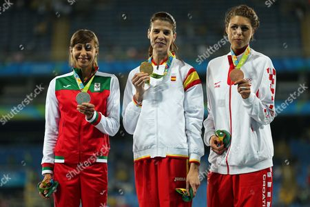 Stock Image of Bulgaria's Mirela Demireva, silver medal, Spain's Ruth Beitia, gold medal and Croatia's Blanka Vlasic bronze medal for the women's high jump during an athletics podium ceremony at the Summer Olympics inside Olympic stadium in Rio de Janeiro, Brazil, Saturday, Aug. 20, 2016