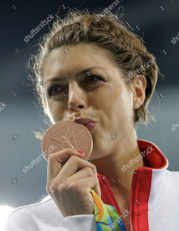 Croatia's Blanka Vlasic kisses the bronze medal she won for the women's high jump during athletics competitions at the Summer Olympics inside Olympic stadium in Rio de Janeiro, Brazil