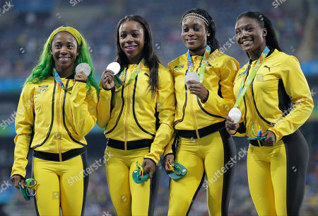 Women's 4 x100 meters silver medalists, Jamaica's Shelly-Ann Fraser-Pryce, Veronica Campbell-Brown, Elaine Thompson, and Christania Williams hold their medals during an athletics podium ceremony at the Summer Olympics at Olympic stadium in Rio de Janeiro, Brazil