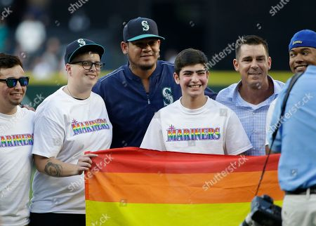 Billy Bean, Felix Hernandez Billy Bean, Major League Baseball vice president of Social Responsibility & Inclusion, second right, stands with Seattle Mariners' Felix Hernandez and members of the LGBTQ community after Bean threw out the ceremonial first pitch before a baseball game between the Mariners and Milwaukee Brewers, in Seattle. The Mariners were celebrating LGBTQ Pride Night at the ballpark