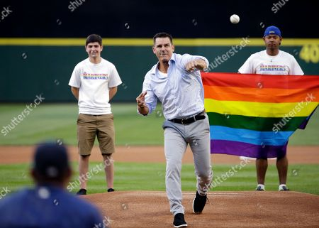 Billy Bean Billy Bean, Major League Baseball vice president of Social Responsibility & Inclusion, throws out the ceremonial first pitch to Seattle Mariners' Felix Hernandez before a baseball game between the Mariners and Milwaukee Brewers, in Seattle. The Mariners were celebrating LGBTQ Pride Night at the ballpark