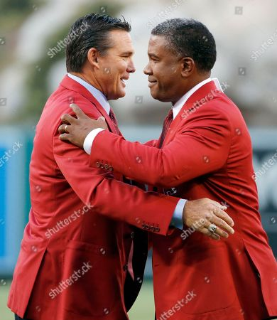 Stock Picture of Garret Anderson, Tim Salmon Former Los Angeles Angels outfielder Garret Anderson, right, one of the all time Angels greats in multiple hitting categories, and his former teammate Tim Salmon embrace as Anderson is inducted into the Angels Hall of Fame during ceremonies before a baseball game between the Angels and New York Yankees in Anaheim, Calif