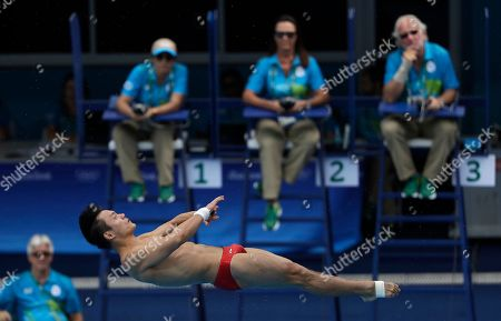 China's Qiu Bo competes during the men's 10-meter platform diving semi-final in the Maria Lenk Aquatic Center at the 2016 Summer Olympics in Rio de Janeiro, Brazil