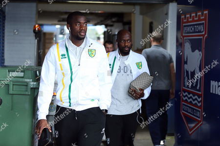 Stock Image of Sebastian Bassong (L) and Youssouf Mulumbu (R) of Norwich City arrives for todays game