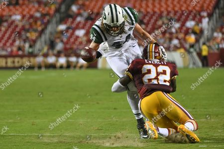 Washington Redskins cornerback Deshazor Everett (22) tackles New York Jets tight end Zach Sudfeld (44) and forces a fumble during the pre-season matchup between the New York Jets and the Washington Redskins at FedEx Field in Landover, MD